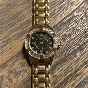 Relic gold plated and rhinestone faced watch